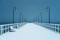 Pier covered with snow. Snowy, moody weather. Stock Photography