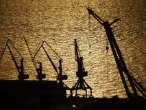 Pier cranes. Cranes in sunset in Belem dockside - Brazil Stock Photography
