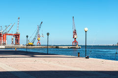 Pier with cranes in harbor, Lisbon (Portugal) Royalty Free Stock Photo