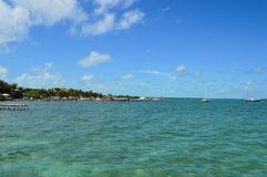 Pier with Crystal Clear Caribbean Waters, Caye Caulker, Belize Stock Photos