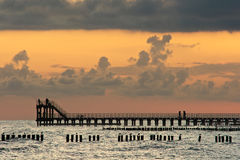 Pier at dawn. Stock Images