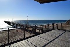 Pier in de zon Stock Foto's