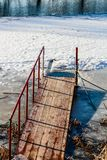 Pier for dipping in the ice. On the river bank stock image