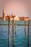 Pier for docking gondolas in Venice. Pier for docking gondolas in Venice, Italy at sunset. In the background is Church of San Giorgio Maggiore Stock Photo