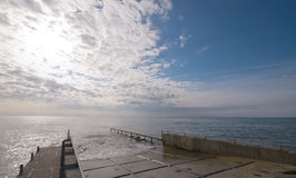 Pier with a dramatic cloudscape Stock Photo