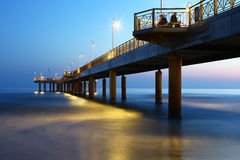 Pier at dusk on tuscanian coast, Italy Stock Image