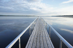 Pier in the early morning. Pier in the lake in the early morning Royalty Free Stock Photography