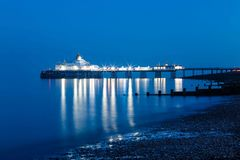 Pier Eastbourne by night, Sussex, United Kingdom. Panorama with pier during the evening in Eastbourne, Sussex, United Kingdom Stock Photos