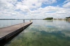 Pier edge lake reflection Stock Photos