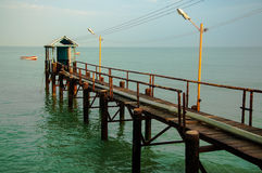 Pier Extending into the Ocean. A view of a pier looking out into the ocean Royalty Free Stock Images