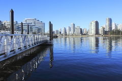 Pier on False Creek, Vancouver. A pier overlooks False Creek and Vancouvers downtown area Stock Photo