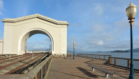 Pier 43 Ferry Arch and Alcatraz Island Royalty Free Stock Photography