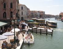 Pier of ferry at Grand canal Venice Italy. Crowd of people and boats along the grand canal Venice Italy Royalty Free Stock Photography