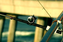 Pier Fishing. Fishing rod in a holder on a California pier royalty free stock images
