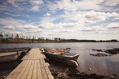 Pier with fishing boats. Royalty Free Stock Photography