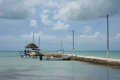 Sarteneja village in Belize. Pier with fishing boats moored in the village Sarteneja, in the Nortern Belize on the Sarteneja Peninsula in the Chetumal Bay stock photo