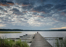 Pier for fishing boats, sunrise at the Lilaste lake, Latvia Royalty Free Stock Images