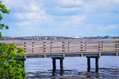 Pier. A fishing pier on Charlotte Harbor with the Tamiami Trail bridge in the background Royalty Free Stock Photography
