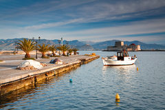 Pier in fishing harbour in Peloponnese, Greece. Royalty Free Stock Image