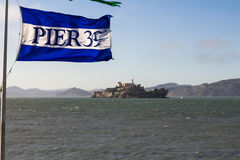 Pier 39 flag with view on Alcatraz Island, San Francisco Stock Photography