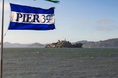 Pier 39 flag with view on Alcatraz Island, San Francisco Stock Photography