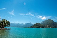 Pier with flowers on the lake of Annecy, in the village of Talloires. stock photos