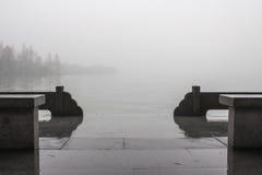 Pier in fog on Lake. Stock Image