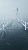 Pier in the fog Royalty Free Stock Photos