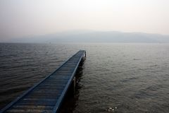Pier on a foggy cloudy day. stock photography