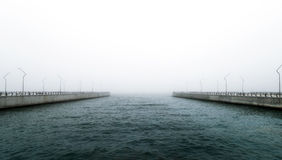 Pier in foggy day Royalty Free Stock Image