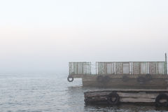 Pier. On a foggy river stock photography