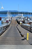 Pier at Friday Harbor in Washington state. Boats docked at pier in Friday Harbor in Washington state during day royalty free stock photos