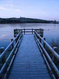 Pier and Frozen lake. A pier on a freezing pre dawn morning in winter Royalty Free Stock Photo