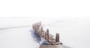 Pier at frozen lake Royalty Free Stock Photo