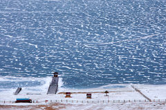 Pier on the frozen Lake Baikal in December Royalty Free Stock Images