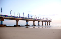 Pier full of spectators Royalty Free Stock Image