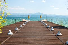 Pier at Sirmione, Garda lake, with Beach Umbrella. Stock Image