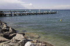 Pier at Garda lake, Italy Royalty Free Stock Image