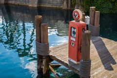 Pier Gas Pump. A replica vintage gas pump on a replica pier Royalty Free Stock Photography