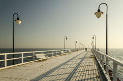 Pier in gdynia orlowo in poland after sunrise in wintertime, europe Stock Photos