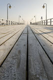 Pier in gdynia orlowo in poland after sunrise in wintertime, europe Royalty Free Stock Photography