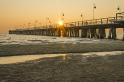Pier in gdynia orlowo in poland after sunrise in wintertime, europe Royalty Free Stock Images