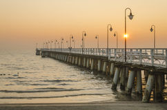 Pier in gdynia orlowo in poland after sunrise in wintertime, europe Stock Image