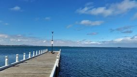 Pier at Geelong VIC Australia. With Blue sky and Clouds at background royalty free stock images