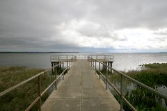 Pier into a gloomy day Royalty Free Stock Image