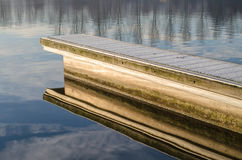 Pier. Golden pier reflecting in the water royalty free stock photography