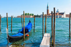 Pier with the gondola in Venice. Pier with the gondola near Saint Mark`s Square in Venice, Italy. The gondola is a traditional romantic transport in Venice Royalty Free Stock Photo