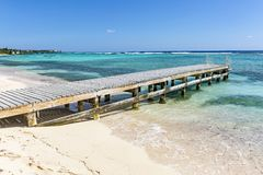 Pier on Grand Cayman beach Royalty Free Stock Photos