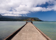 Pier at Hanalei Bay on Kauai. View down the pier at Hanalei in Kauai towards the Na Pali coast royalty free stock image