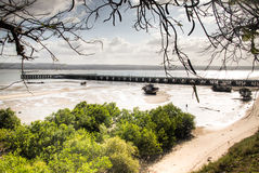 The pier in the harbour of Inhambane with old boats Stock Photos